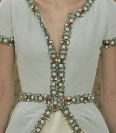 Pale green, silver and opalescent crystal dress detail