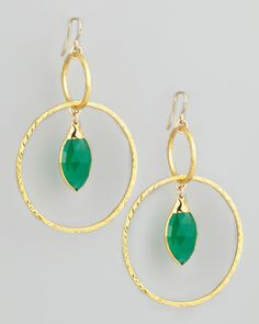 They'd have great movement. (Hammered Gold Hoop Earrings |  Devon Leigh)