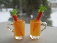Dollhouse Miniatures, 1:12 scale  This is a handmade orange drink for your favorite bunny rabbit. The mug of orange drink has a handmade carrot sticking out of the top. Since I have more than one set available, they will vary. You will receive a set of 2. Enjoy.  Measures Approximately:  5/8 x 5/8 high (but 1 1/8 tall to top of greens on carrot)   Handmade by me.