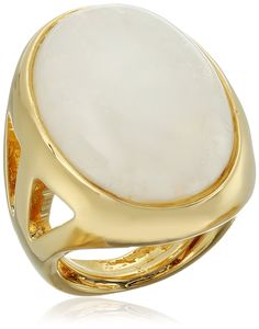 Kenneth Jay Lane Polished Gold Open Side and White Quartz Center Ring, Size 5-7. Ring adjusts between sizes 5-7. Made in United States. adjustable ring with cutout sides and opal center. Made in USA.