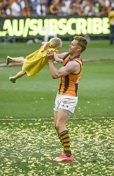"""AFL grand final Best pictures from Hawthorn celebrations - Sam Mitchell: """"I've still got plenty of petrol tickets left, I'm contracted for next year Sam Mitchell, Australian Football League, Fantasy Football, Winter Sports, Football Players, Biceps, Finals, Cool Pictures, Hawks"""