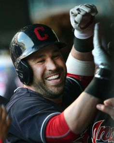 Cleveland Indians Jason Kipnis gets congrats in the Indians dugout after hitting a solo home run against the Oakland Athletics in the first inning at Progressive Field in Cleveland, Ohio on July 30, 2016.  Indians won 6-3   (Chuck Crow/The Plain Dealer)