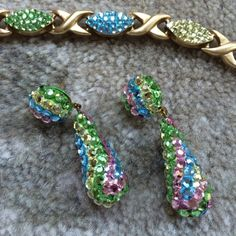 Vintage bracket and earring set Amazing bracelet and eating set... Like mint condition.  Beautiful pastel stones Accessories