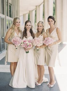 Champagne bridesmaids with pink flowers