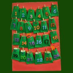 El calendario de Adviento es uno de los símbolos de la Navidad. Este año, en vez de comprar uno ya hecho, Guiainfantil te propone que lo realices en casa con los niños de forma sencilla, divertida y barata ya que es una manualidad de reciclaje. 9 And 10, Advent Calendar, To My Daughter, Holiday Decor, Ideas, Shape, Home, Toddler Christmas Crafts, Creative Crafts