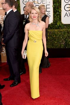 Naomi Watts in a bright yellow Gucci column gown, paired with a Bulgari diamond snake necklace.