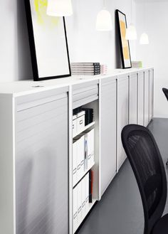GALANT white roll-front cabinets along a wall