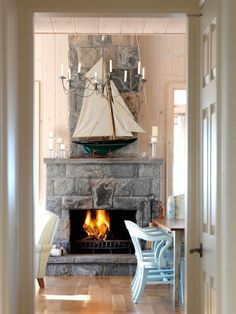 model sailboat + stone fireplace = traditional yet stylish coastal mantelpiece decoration
