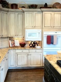 Light (whitewash) cabinets, medium counter top, dark floor. Too streaky on cabinets. To illustrate contrasts