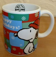 "Peanuts Happy Holidays Ornament Motif Snoopy Ceramic Coffee Mug Cup  Measures 3 3/4"" tall and 3 1/8"" wide without handle and 4 1/2"" including the handle  Design on both sides of mug.    Black emblem on the inside lip of the mug that says Celebrate Peanuts 60 years with dancing Snoopy  Exc..."