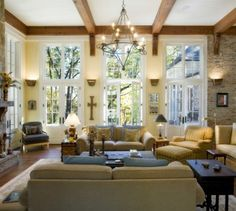 Neat wood beams in a cheery bright living room