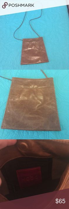 Camel Hobo brand Cross body Camel Hobo Brand Crossbody purse NWOT!! The perfect neutral purse. Has magnetic closure and plenty of room inside. HOBO Bags Crossbody Bags