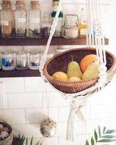 Think outside the box! Maybe you don't have a green thumb but still love macrame plant hangers? Hang a macrame plant hanger as fruit bowl in the kitchen. #stylingtips #modernmacrame