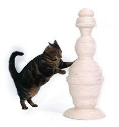 Awesome and pretty cat post decor for the home. I imagine any thrift store bed post could serve well with some sissal twine wrapped around it, and a nice chunky base attached to keep it upright!