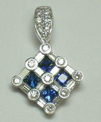blue sapphire and diamond pendant.  Countryman's Village jewelers