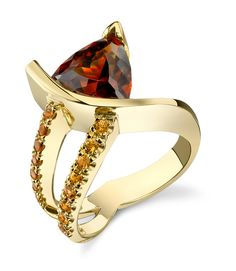 Custom created by Sami. 14K two tone Spessartite and yellow diamond ring.