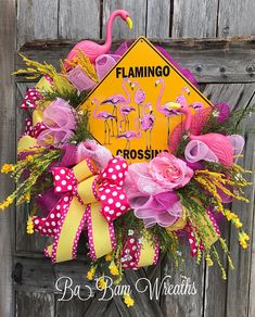 Flamingo Wreath, Flamingo Decor, Flamingo Door Hanging, Summer Wreath, Summer Decor, Beach Wreath, Beach Decor, Pool Party, Tropical Decor  Flamingo Crossing   Wow your neighbors with this head turning beauty! Bright colors of hot pink & yellow~ say a warm HELLO! This wreath is a head turner~ maxed out in detail from the metal flamingo crossing sign to the flamingo picks~ tons of florals in a wide variety! This wreath is STUNNING! Measures XL at 30 inches in length & 26 inches w...