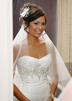 classic bridal updos with veil under the hair | Wedding-hairstyle-sideswept-updo-with-tendrils-white-fabric-flower-in ...