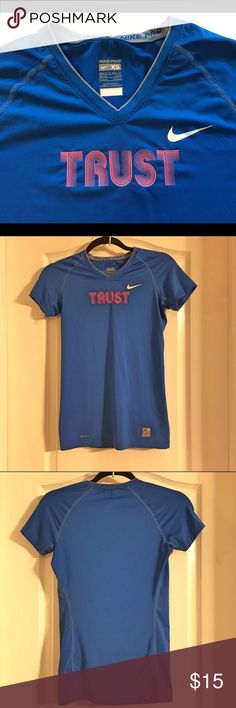"""Nike Dri Fit """"Trust"""" T-Shirt Nike Dri Fit """"Trust"""" T-Shirt ~ Colors are royal blue and pink ~ Size X-Small ~ UA to UA is approximately 14"""" ~ Length is approximately 25 1/2"""" ~ 84% Polyester & 16% Spandex Nike  Tops Tees - Short Sleeve"""