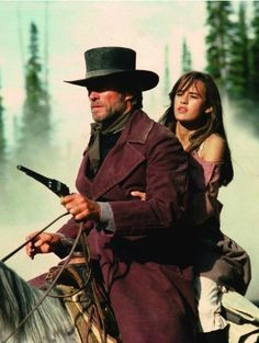 "Clint Eastwood and Sydney Penny in ""Pale Rider"" (1985). Director: Clint Eastwood."