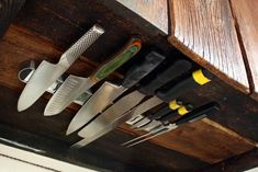 Kaela Porter writes the blog Local Kitchen and lives in a small 1,000-square-foot cottage. Because of space limitations, she needed to come up with a clever storage solution for her knives. She installed a magnetic knife rack underneath her kitchen cabine