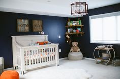 Rustic Meets Modern Nursery - love the bold navy wall and rustic accents!