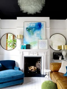 large round mirrors, art over mantel