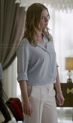Emily's light blue button down blouse and white seam front pants on Revenge.  Outfit Details: http://wornontv.net/39164/ #Revenge