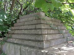 "Largely forgotten in the woods of rural Indiana, the Great Pyramid of Bedford-Needmore is little more than a pile of stones. It was an effort to build a limestone ""amusement park"" near the Limestone Capital of America, Bedford Indiana. Abandoned Amusement Parks, Abandoned Places, Bedford Indiana, Bloomington Indiana, Most Haunted Places, Concrete Building, Home Of The Brave, Land Of The Free, Great Wall Of China"