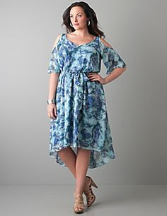 With perfectly-placed cold shoulder cut-outs, alluring V-neck, and asymmetric hem our snake print dress flaunts what you've got. Short sleeves, elastic waist and flattering tie belt complete the look. Fully lined.  lanebryant.com