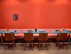 Louis Pretty Deli in Berlin | Yellowtrace_ Bright orange, blue laminate table, pink banquette, bold, colour blocking colours