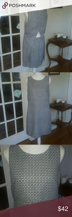 J.Crew black and white peekaboo Jacquard dress 8 This dress is so beautiful and unique. Very elegant black and white design with a cut out peekaboo in the back that makes it resemble 2 pieces.  Size 8, EXCELLENT condition.  Inside is lined.  Bundle and save! J. Crew Dresses