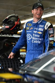 Dale Earnhardt Jr., driver of the #88 Time Warner Cable Chevrolet, looks on in the garage area during practice for the NASCAR Sprint Cup Series Bank of America 500 at Charlotte Motor Speedway on October 10, 2013 in Concord, North Carolina.