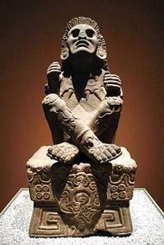 Samael Aun Weor: In Museum of Anthropology and History of Mexico City is found Xochipilli seated upon a beautifully carved basalt cube. He has his knees up high and his legs crossed like the cross of Saint Andrew, his hands above his knees with their respective index fingers and thumbs in contact.