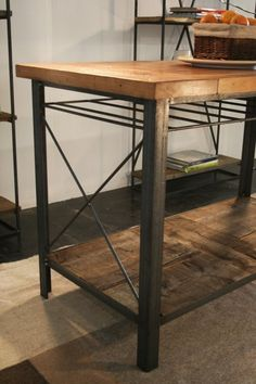 Gorgeous. Kitchen island made out of wood reclaimed from an apartment building from Times Square that was built in the early 1900's. The base is made out of 100% recycled steel.