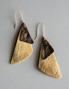 Loa Designs Calavera Brass & Recycled Leather Earrings.  The style looks like you can do it with metal (soup cans, etc) also.