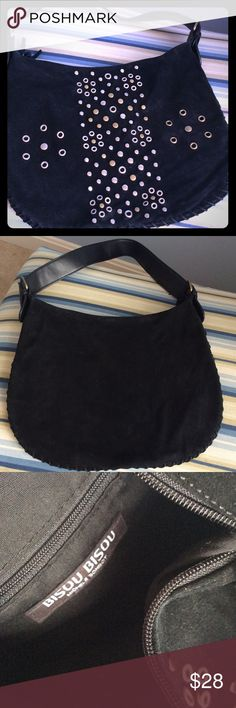 ❤Bebe SUEDE BAG WITH GROMETS BLACK SUEDE BAG WITH GROMETS AND BUCKLES ON STRAP. INSIDE HAS A ZIP POCKET AND ZIP CLOSURE. bebe Bags