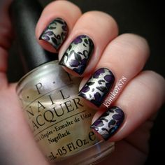 """I used a black polish and wiped off the middle portion of it and topped it with OPI's """"I'm a Princess, You're Not!"""" Then painted the design with acrylic paints"""
