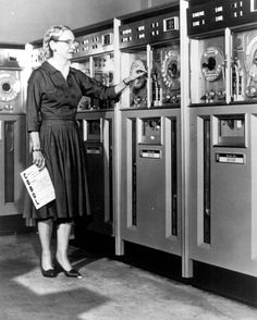 Grace Hopper, American computer scientist, stands in front of a Univac mainframe in 1952. She designed one of the first commercial large-scale electronic computer (UNIVAC I), developed COBOL which made it possible for computers to respond to words and not just numbers, and one of only a few female admirals in the U.S. Navy