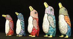 Finished examples of lightweight paper mâché penguins made with long skinny balloons...great tutorial for making!!