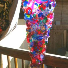 Chihuly inspired art glass installation for our school library.  Made by coloring clear, plastic drinking cups with Sharpies, then baking.  3rd grade project.