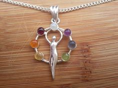 Check out this item in my Etsy shop https://www.etsy.com/listing/204740407/goddess-chakra-pendant-necklace
