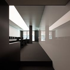 PBS office in Barcelona by Francesc Rife /// Beyond lighting a specific area, the lighting surface is integrated within the ceiling partitions, balancing the overall visual composition.