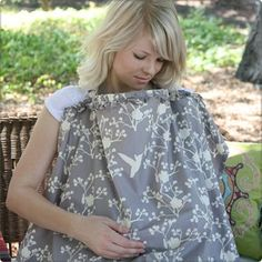 """Hooter Hiders"" Nursing Covers: (I know, it's a ridiculous name!) but these are the BEST!! They have boning in the neckline, so you can easily peek down to see how baby is doing and ensure the fabric is not suffocating him/her while you're nursing!"