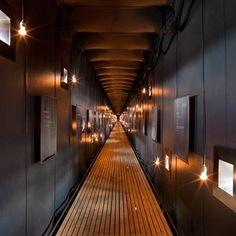 Steilneset Memorial ~ Norway.  Inside this corridor, light bulbs hang behind 91 windows to represent each of the men and women that were put to death during the witch trials.