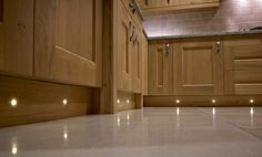 Beautiful warm white plinth lighting in a traditional kitchen by Sensio