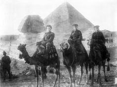 Three unidentified New Zealand servicemen riding camels during World War I, the Sphinx and a pyramid in the background. (James McAllister/National Library of New Zealand) #