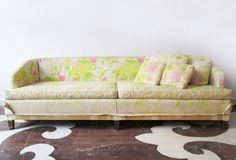 "There is a stunning mid-century sofa underneath this Rosemary's-Baby-gone-wrong floral fabric. / 90"" wide x 28.5"" high x 27"" inside seat depth  / 650.00 to purchase as shown / 925.00 to reupholster / 16 yards fabric needed"