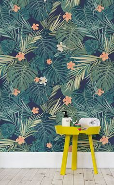 Into the Jungle. This beautiful wallpaper design features eye-catching tropical leaves and dainty hibiscus flowers. Combine with accompanying bright furnishings like this yellow Muuto table to complete the look! Perfect for bathroom spaces.