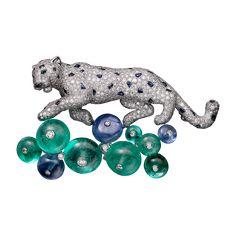 Cartier. Panthere de cartier. Platinum, diamond, emerald, sapphire & onyx panther brooch...♡